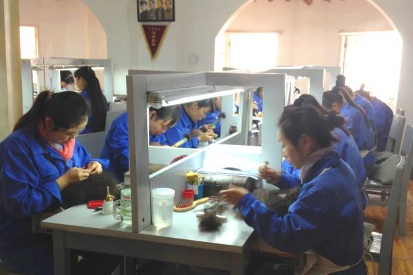 Photographie d'un atelier de couture.