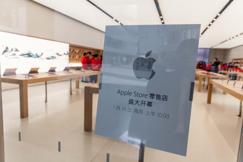 Photo d'employés chinois dans un magasin Apple