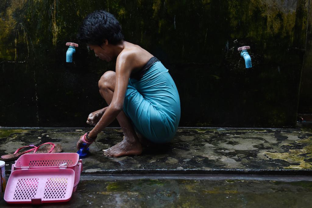 Vie quotidienne dans le centre pour malades du Sida de la Ligue Nationale pour la Démocratie dans la banlieue de Rangoun. (Crédits : AFP PHOTO / ROMEO GACAD)