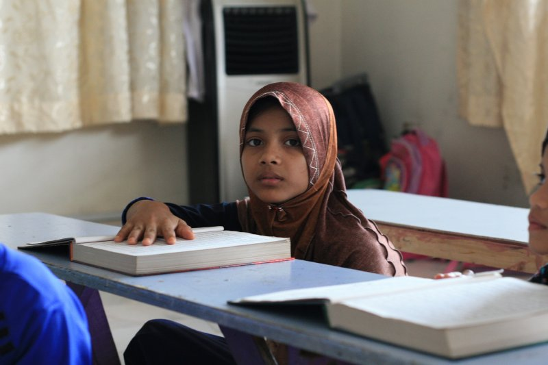 Jeune Rohingya à l'école de Human Aid. (Copyright : Marine Vial)