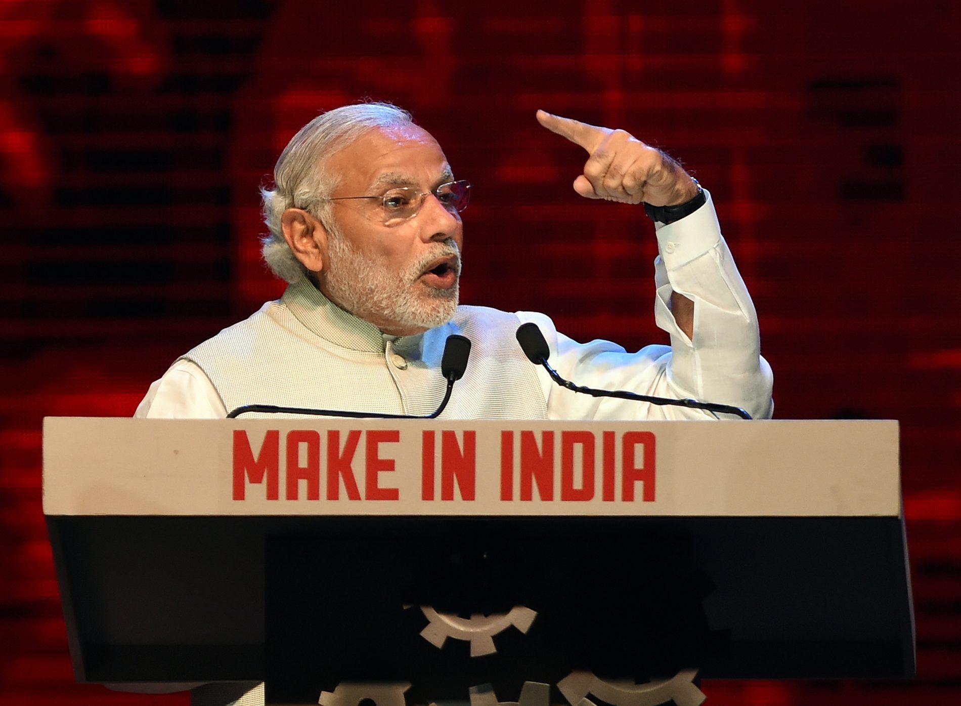 """Le Premier ministre indien Narendra Modi lors de la cérémonie d'inauguration de la première semaine du """"Make in India Week"""" à Mumbai, le 13 février 2016. (Crédits : AFP PHOTO / PUNIT PARANJPE)"""