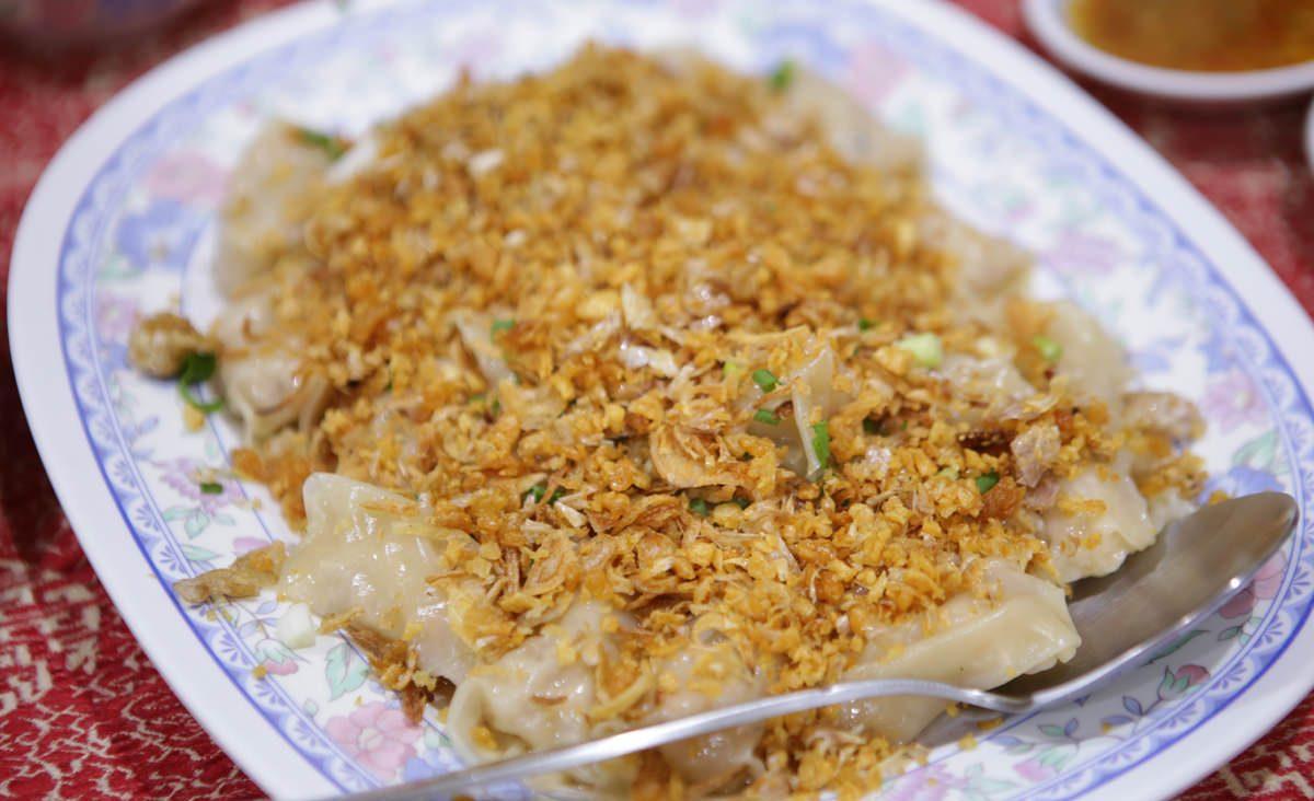 Canard au cacahuète au Jok, restaurant chinois caché de Bangkok. (Source : Bangkok.com)