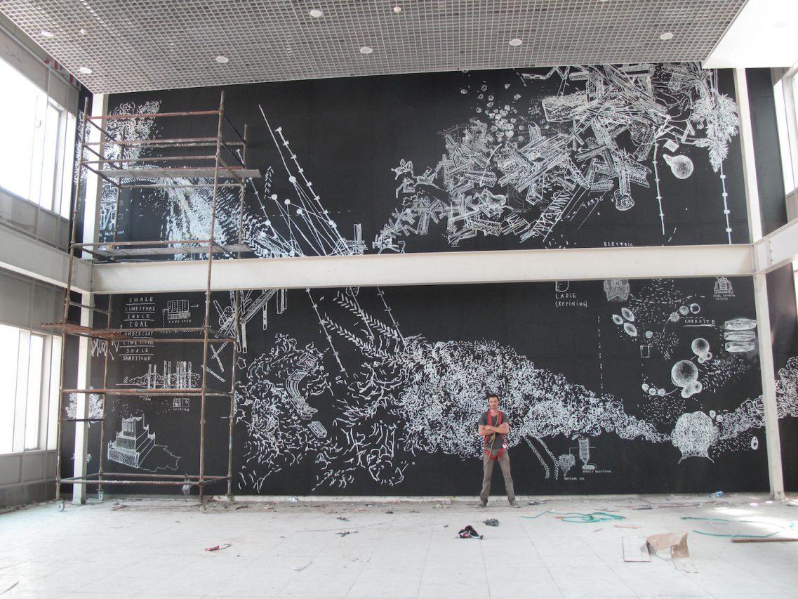 Fresque murale par Julien Segard - 8x15m - installée dans le hall de la cantine. (Crédit : Julien Segard)