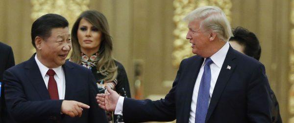 Le président chinois et son homologue américain Donald Trump reçu à un dîner d'État au Grand Hall du Peuple à Pékin, le 9 novembre 2017. (Source : Vox)