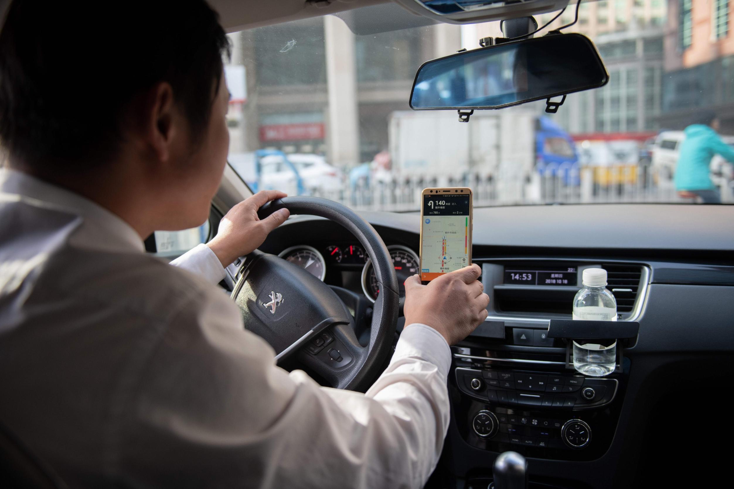 Didi Chuxing, plateforme chinoise de VTC, contrôle environ 90 % du marché des courses partagées en Chine. (Source : CNN)